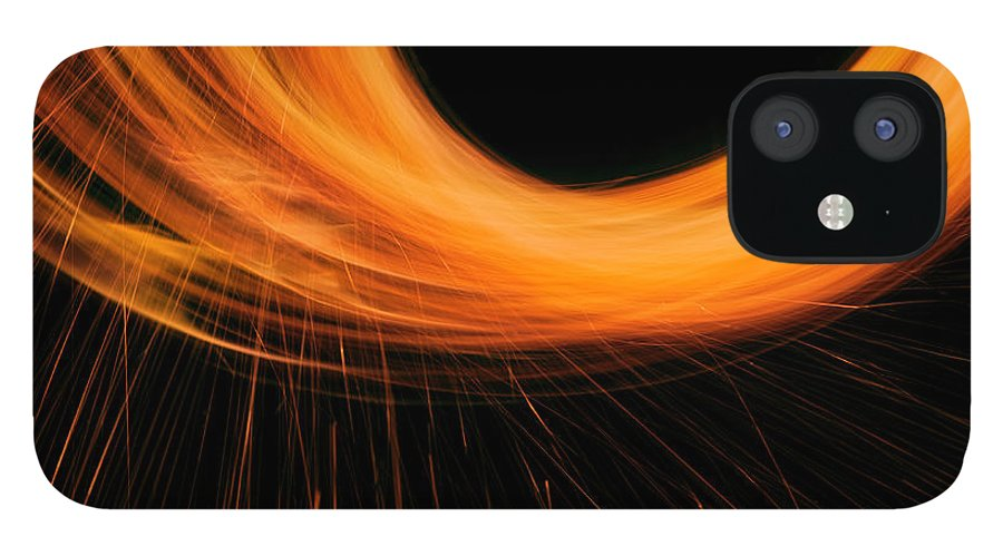 Orange Color IPhone 12 Case featuring the photograph Circle Of Light With Sparks by Jonathan Knowles