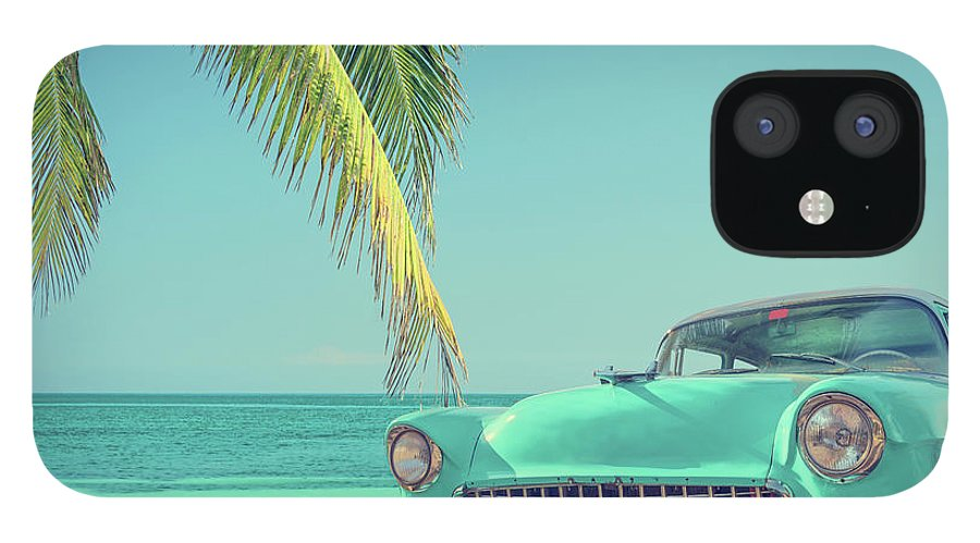 Scenics IPhone 12 Case featuring the photograph Classic Car On A Tropical Beach With by Delpixart