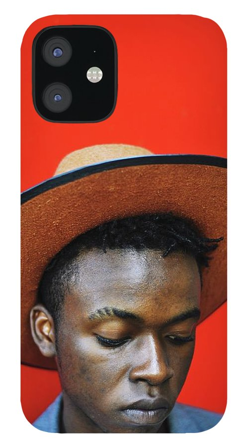 Young Men IPhone 12 Case featuring the photograph Close-up Of Man Wearing Hat Against Red by Samson Wamalwa / Eyeem
