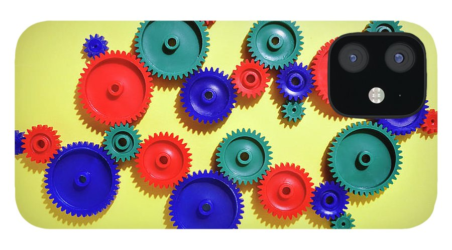 Working iPhone 12 Case featuring the photograph Colored Gears by Joseph Clark
