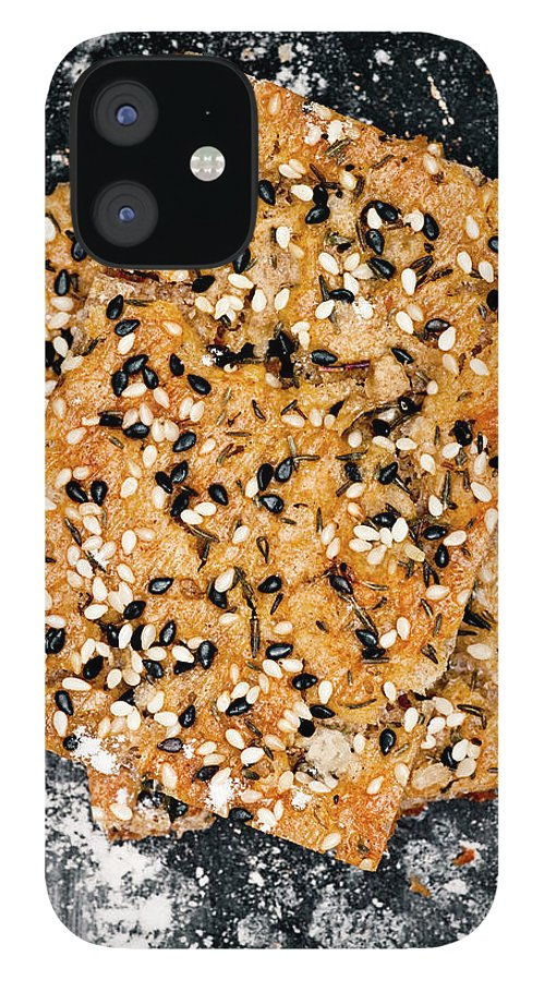 Sweden IPhone 12 Case featuring the photograph Crispbread With Thyme On Metal Sheet by Johner Images