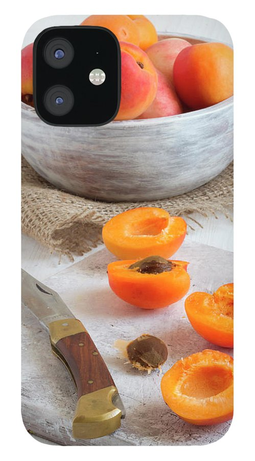 Cutting Board iPhone 12 Case featuring the photograph Cross Section Apricots With Knife And by Westend61