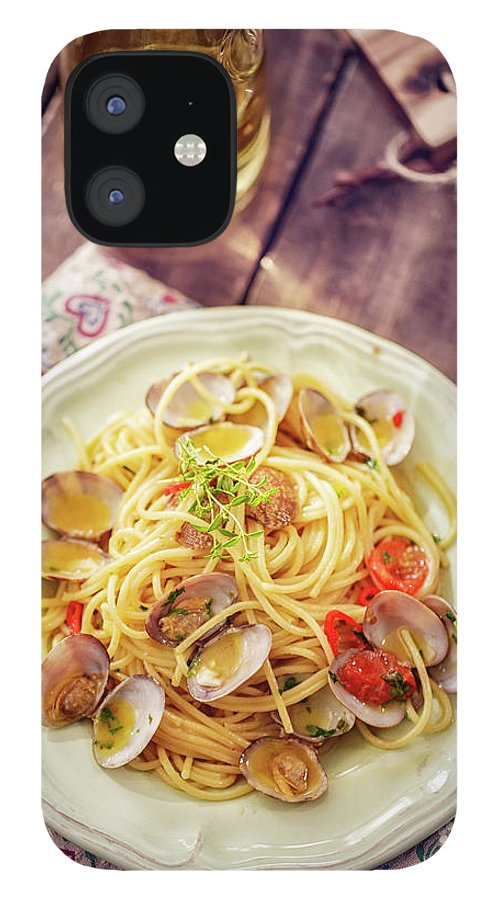 Italian Food IPhone 12 Case featuring the photograph Delicious Spaghetti Alla Vongole Served by Gmvozd