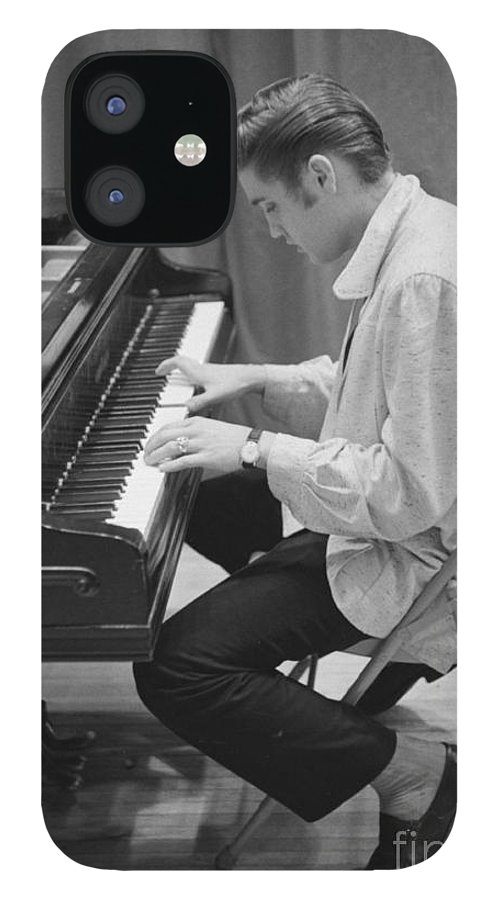 Elvis Presley IPhone 12 Case featuring the photograph Elvis Presley on piano while waiting for a show to start 1956 by The Harrington Collection