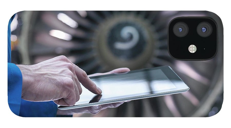 Focus IPhone 12 Case featuring the photograph Engineer Using Digital Tablet In Front by Monty Rakusen