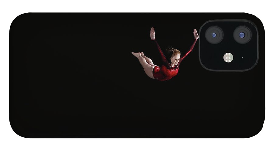 Focus iPhone 12 Case featuring the photograph Female Gymnast Soaring Through Air by Mike Harrington