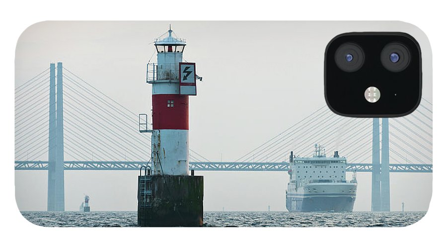 Copenhagen IPhone 12 Case featuring the photograph Ferry On Sea, Oresund Bridge In by Johner Images