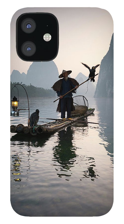 Chinese Culture IPhone 12 Case featuring the photograph Fisherman With Cormorants On Li River by Matteo Colombo