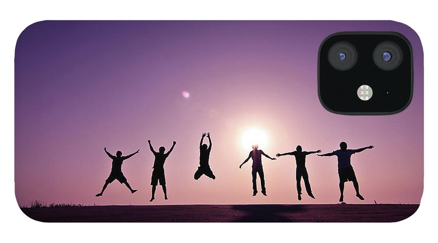 Human Arm IPhone 12 Case featuring the photograph Friends Jumping Against Sunset by Kazi Sudipto Photography