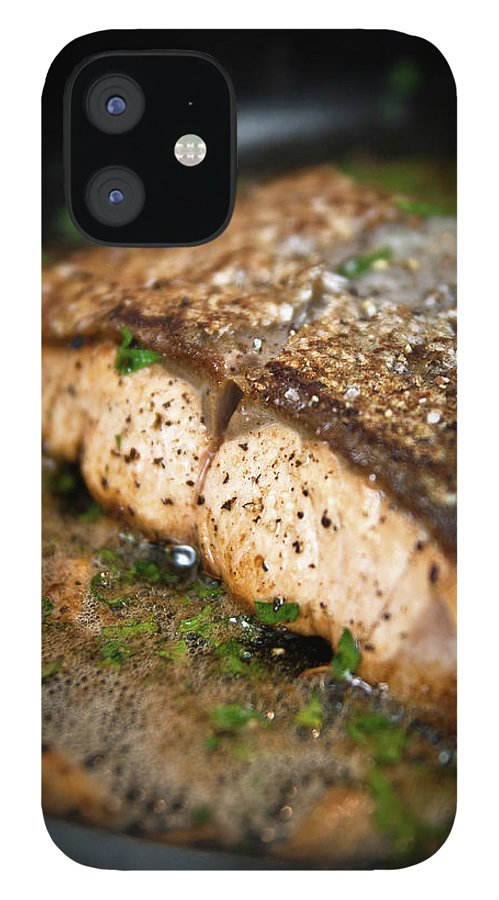 Garlic IPhone 12 Case featuring the photograph Frying Salmon On Pan by Wojciech Wisniewski