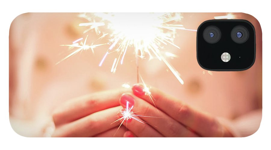 Firework Display IPhone 12 Case featuring the photograph Girl Holding Small Sparkler by Sasha Bell