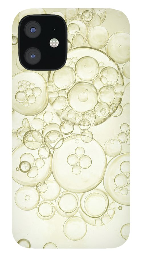 Purity IPhone 12 Case featuring the photograph Gold Bubbles Of Oil And Water by Level1studio