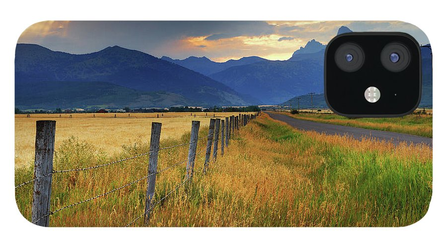 Tranquility IPhone 12 Case featuring the photograph Grand Tetons At Sunrise From Driggs by Anna Gorin
