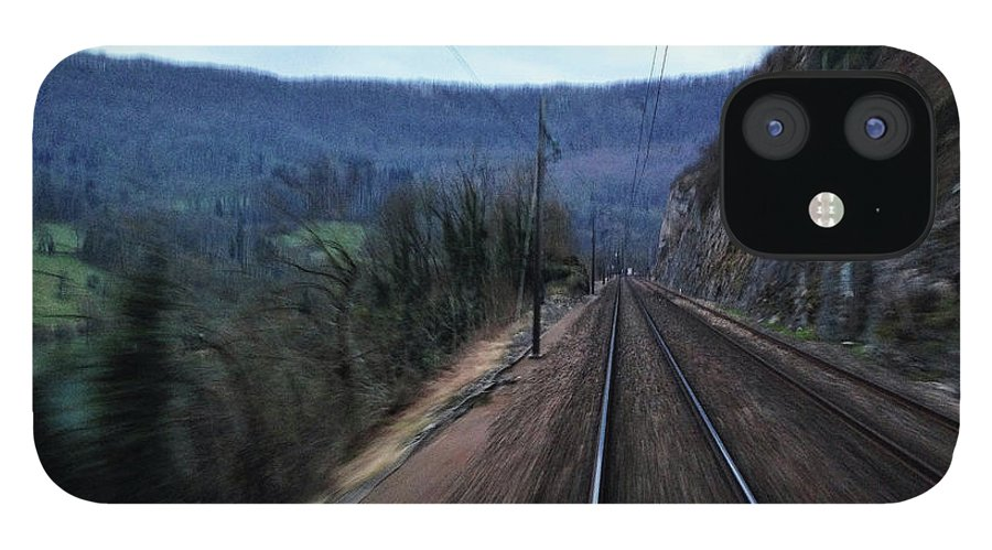 Railroad Track iPhone 12 Case featuring the photograph Green Travel by Lazypixel / Brunner Sébastien