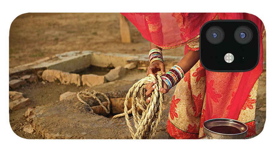 Working IPhone 12 Case featuring the photograph Indian Woman Getting Water From The by Hadynyah
