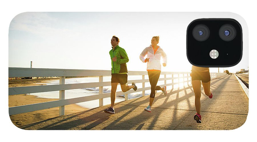 Young Men IPhone 12 Case featuring the photograph Jogging Along The Coast by Jordan Siemens