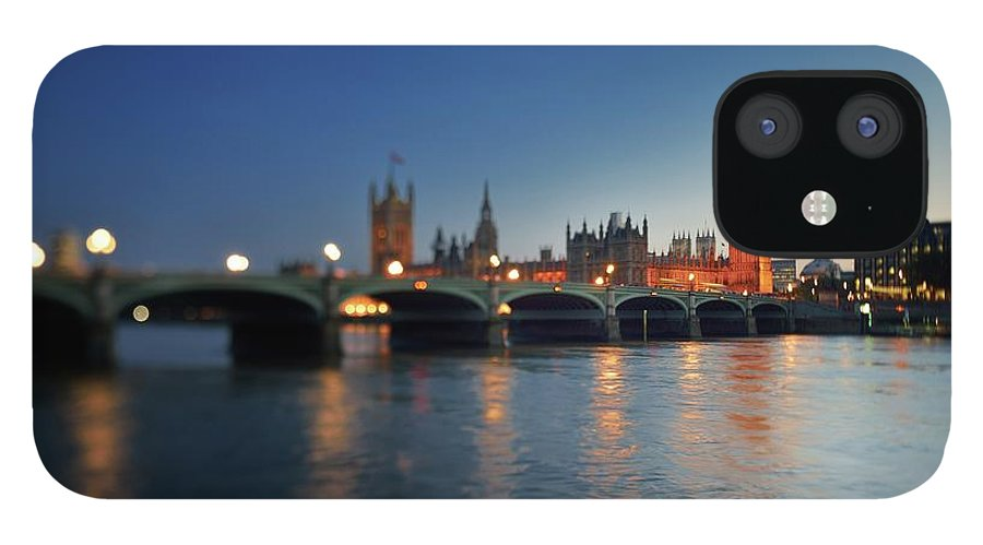 Tranquility IPhone 12 Case featuring the photograph London, Palace Of Westminster At Sunset by Vladimir Zakharov