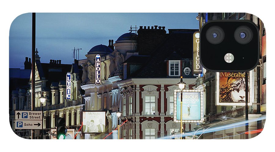 Recreational Pursuit iPhone 12 Case featuring the photograph Londons Shaftesbury Avenue At Dusk by Shomos Uddin