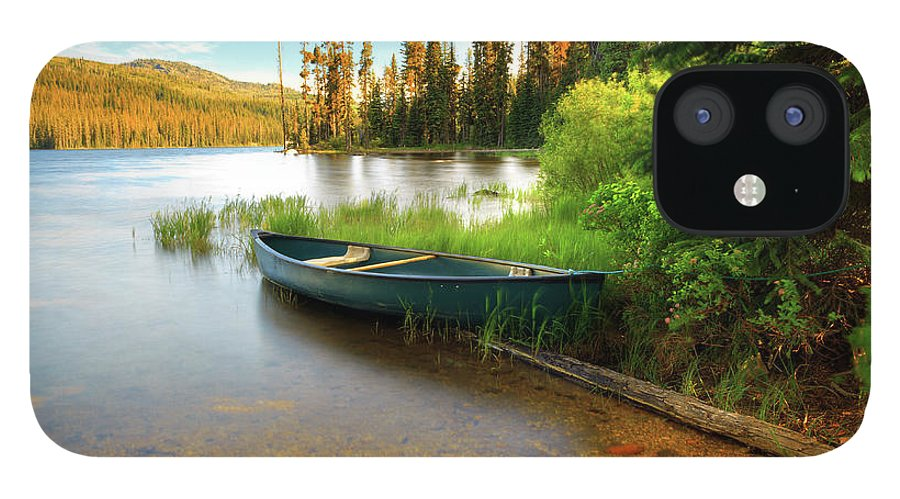 Tranquility IPhone 12 Case featuring the photograph Lone Canoe On Shores Of Upper Payette by Anna Gorin