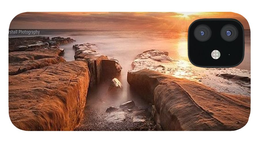 IPhone 12 Case featuring the photograph Long Exposure Sunset At A Rocky Reef In by Larry Marshall