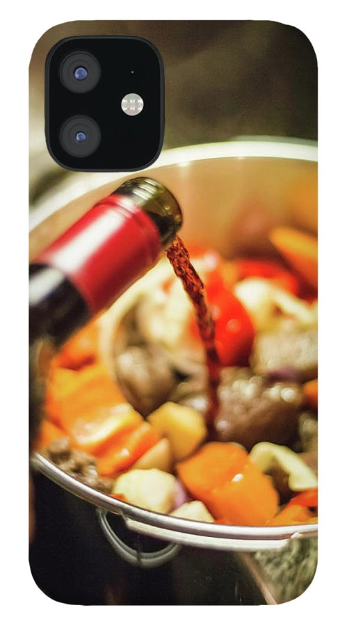 Mature Adult IPhone 12 Case featuring the photograph Man Pouring Wine Into Vegetables by Manuel Sulzer