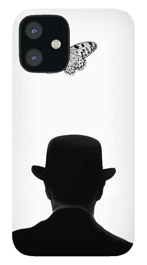 Mature Adult IPhone 12 Case featuring the photograph Man Standing Under Butterfly by Grant Faint