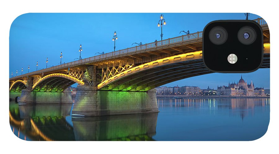 Town IPhone 12 Case featuring the photograph Margaret Bridge And The Parliament by Focusstock