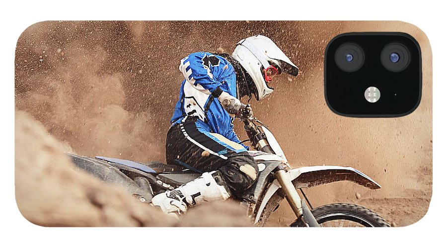 Crash Helmet IPhone 12 Case featuring the photograph Motocross Biker Taking A Turn In The by Daniel Milchev