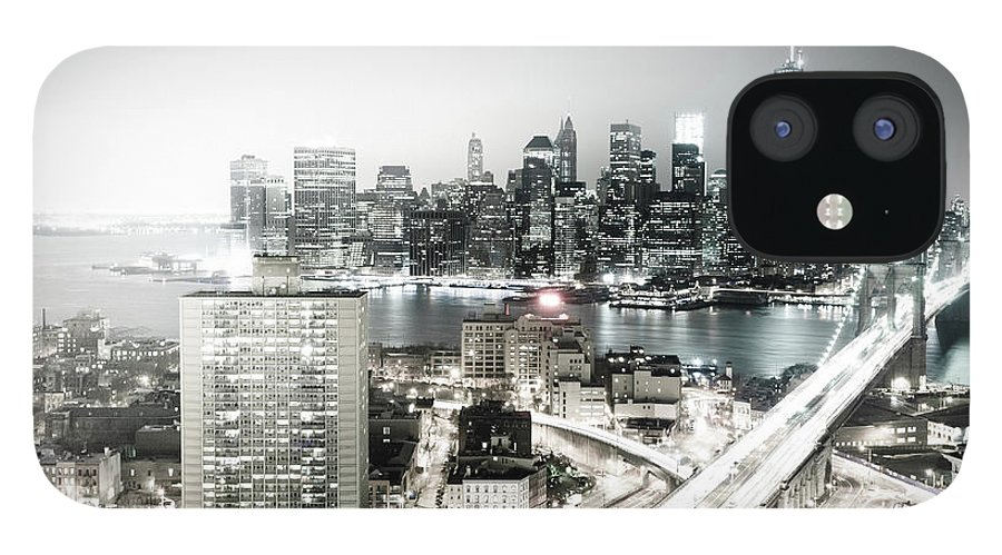 Lower Manhattan IPhone 12 Case featuring the photograph New York City Skyline At Night by Mundusimages
