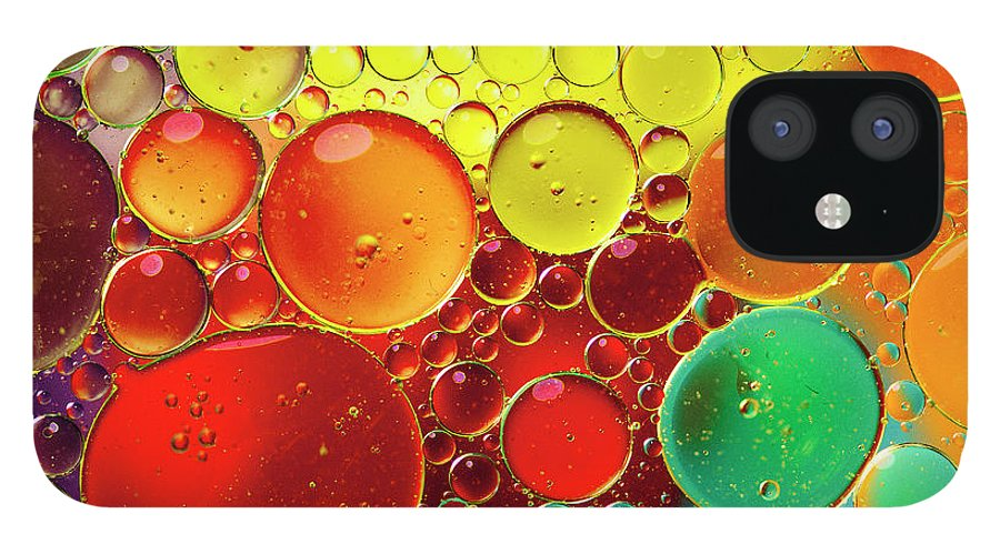 Full Frame IPhone 12 Case featuring the photograph Oil Bubbles In Water by Ramoncovelo