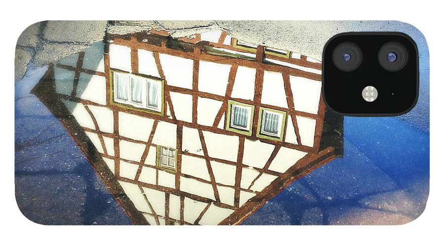 Reflection IPhone 12 Case featuring the photograph Old half-timber house upside down - water reflection by Matthias Hauser