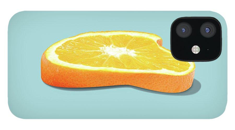 Orange iPhone 12 Case featuring the photograph Orange Fruit Slice by Dan Cretu