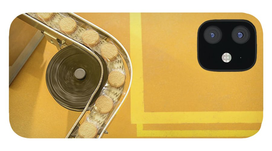 Manufacturing Equipment IPhone 12 Case featuring the photograph Overhead View Of Freshly Made Biscuits by Monty Rakusen
