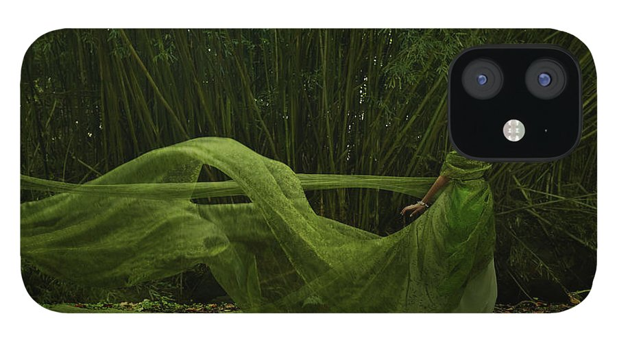 Tranquility IPhone 12 Case featuring the photograph Pacific Islander Woman In Flowing Green by Colin Anderson Productions Pty Ltd