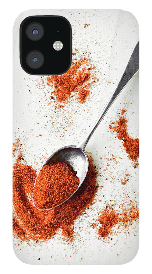 Atlanta IPhone 12 Case featuring the photograph Paprika Powder In A Spoon by Natalia Ganelin