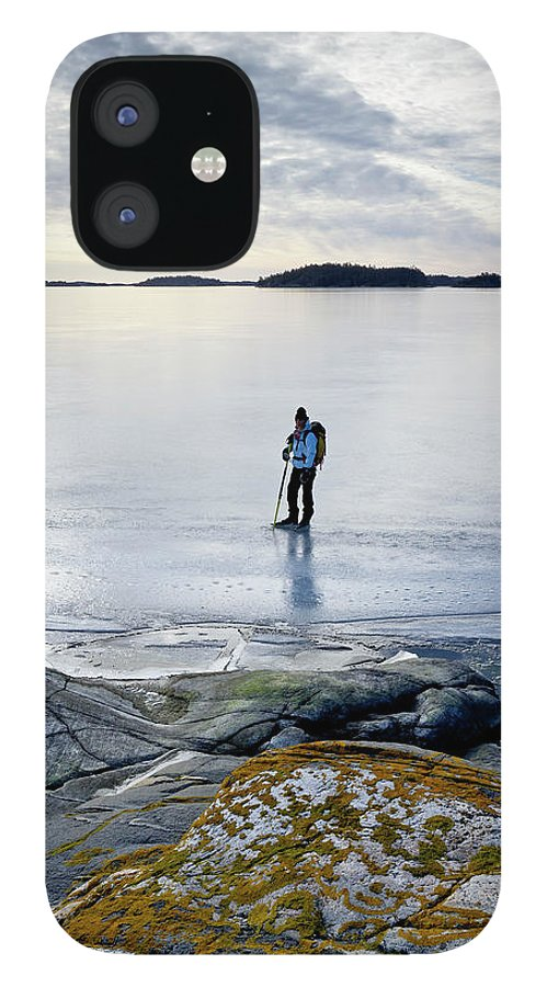 Archipelago iPhone 12 Case featuring the photograph Person Skating At Frozen Sea by Johner Images