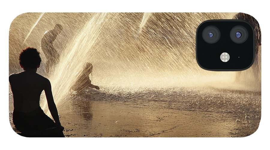 People IPhone 12 Case featuring the photograph Playing In The Fountain by Zeb Andrews