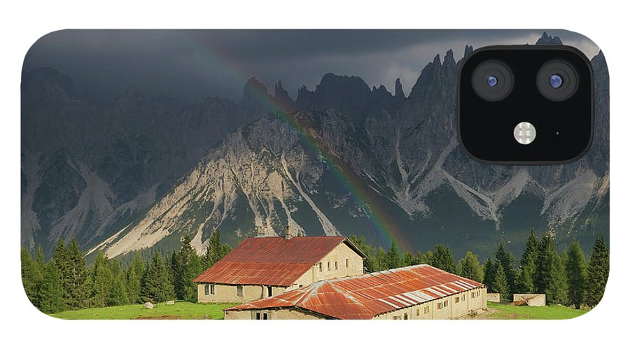 Belluno IPhone 12 Case featuring the photograph Rainbow Over Casera Vedorcia Dolomites by Albertosimonetti