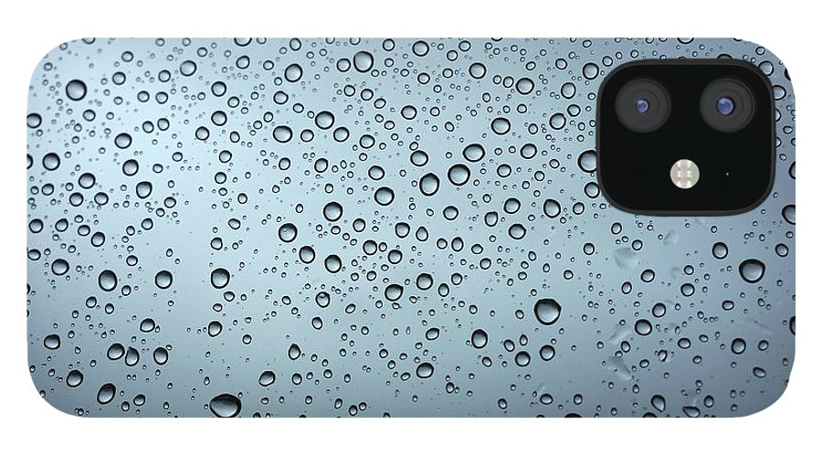 Horizontal iPhone 12 Case featuring the photograph Rainy Day Out by Nigel Killeen