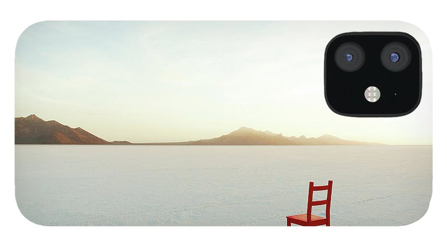 Tranquility IPhone 12 Case featuring the photograph Red Chair On Salt Flats, Facing The by Andy Ryan