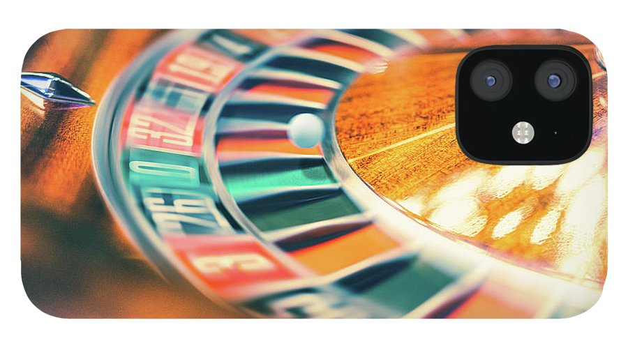 Risk iPhone 12 Case featuring the photograph Roulette Wheel In Motion by Deimagine