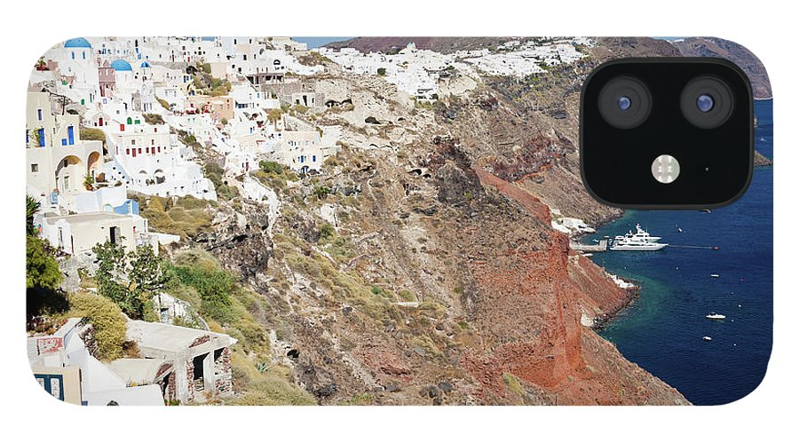 Tranquility IPhone 12 Case featuring the photograph Rows Of Houses Perch On Cliff In Oia by Melissa Tse