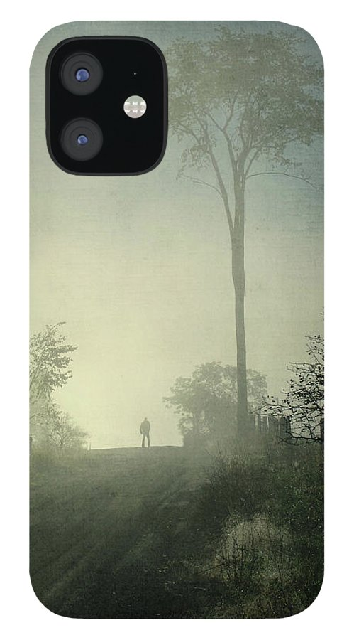 Tranquility iPhone 12 Case featuring the photograph Silhouette Of A Man In Fog by Francois Dion