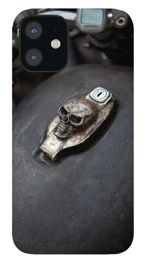 Berlin IPhone 12 Case featuring the photograph Skull Design On Motorcycle Ignition by Andreas Schlegel