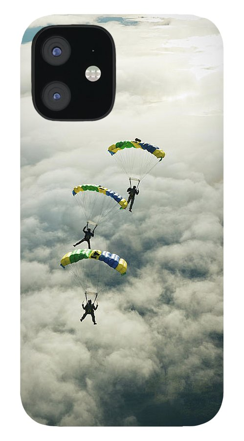 Young Men iPhone 12 Case featuring the photograph Skydivers In Mid-air by Johner Images