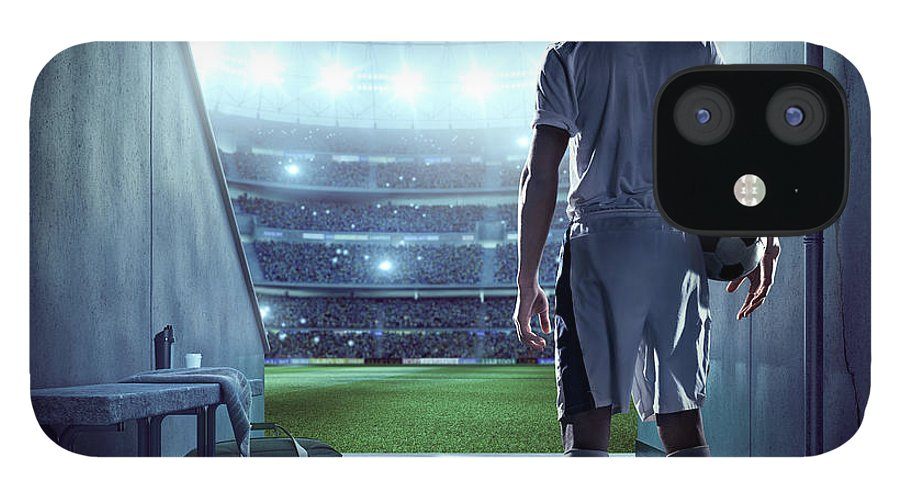 Event IPhone 12 Case featuring the photograph Soccer Player In Players Zone Of A by Dmytro Aksonov