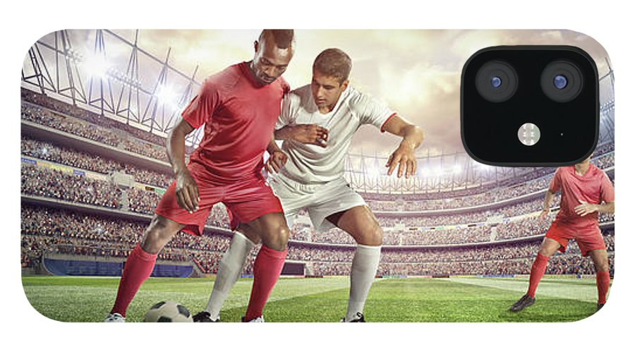 Soccer Uniform IPhone 12 Case featuring the photograph Soccer Player Tackling Ball In Stadium by Dmytro Aksonov