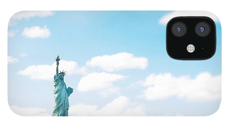 Lower Manhattan IPhone 12 Case featuring the photograph Statue Of Liberty On New York City by Franckreporter