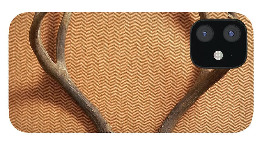 Material IPhone 12 Case featuring the photograph Still Life Of Deer Antlers On A Fabric by Gwen Rodgers