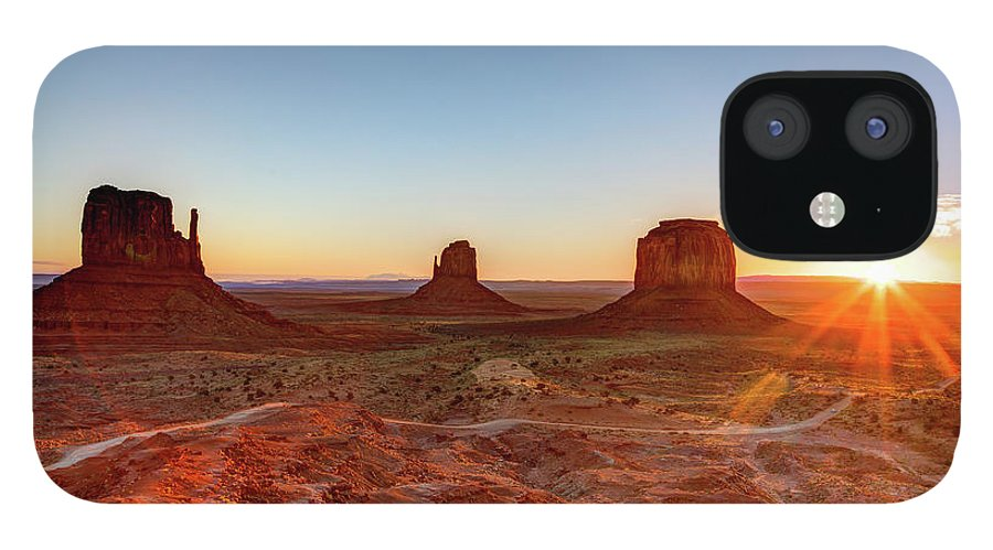 Tranquility IPhone 12 Case featuring the photograph Sunrise On Monument Valley by Loic Lagarde